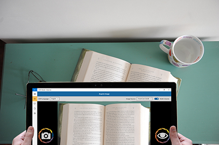 The KNFB Reader app being used on a Surface tablet to scan a book.